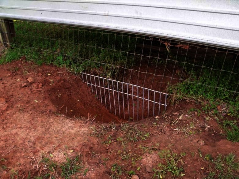 keep dog from digging under fence
