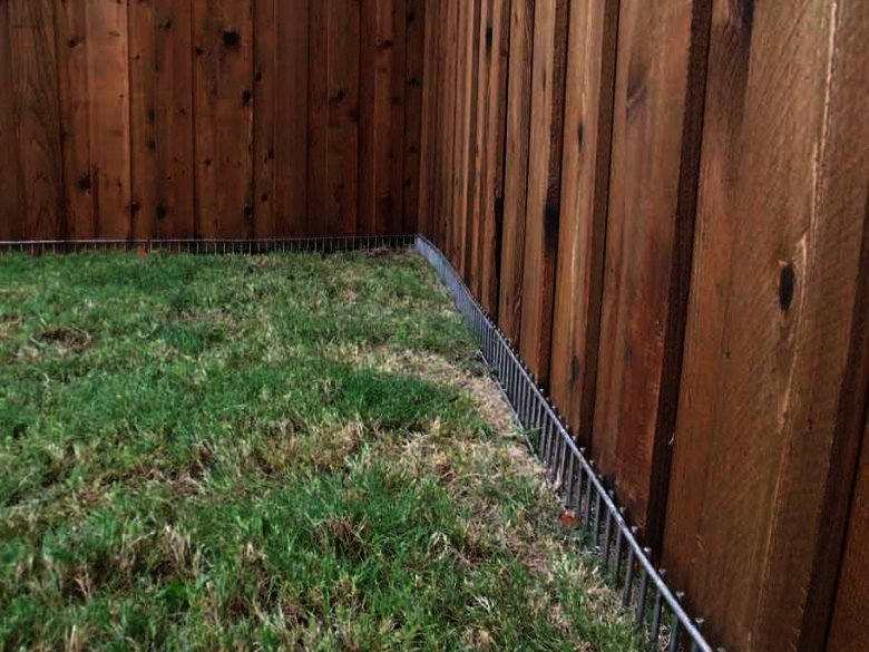 how to keep a dog from digging under the fence